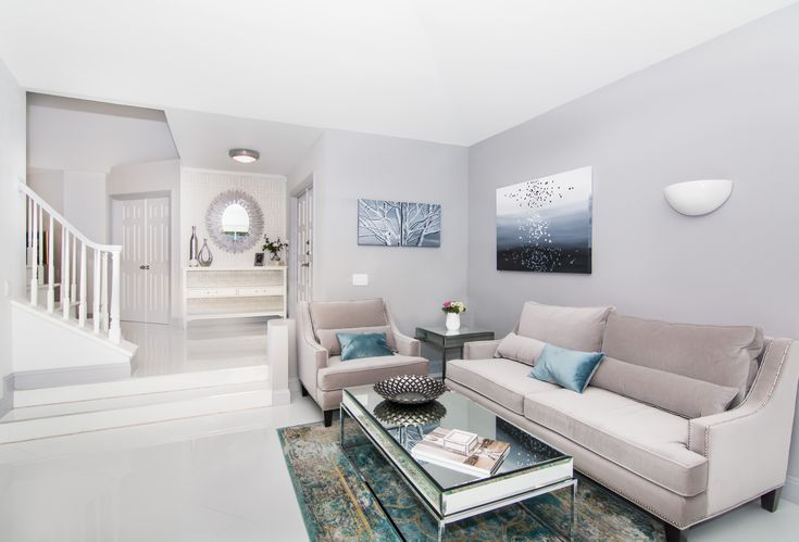 Monochromatic Living Room With Just A Little Pop Of Teal Clean