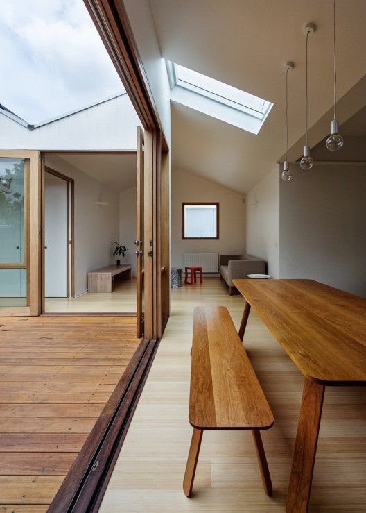 Newly light, airy space in renovated Brunswick East house, Melbourne, Australia | Architects: Black Line One X Architecture Studio; Builder: Genjusho Furniture: 'Earl Pinto' and Ross Gardam. Photo by Peter Bennetts | Seeking an addition to their typically dark Californian Bungalow, the clients emphasized the sustainable performance of their future home. [Please keep photo credit and original link if reusing or repinning. Thanks!]