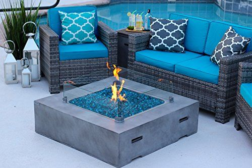 "42"" x 42"" Square Modern Concrete Fire Pit Table w/ Glass Guard and Crystals in Gray by AKOYA Outdoor Essentials (Cobalt Blue)  42"" x 42"" Square Modern Fiber Concrete Fire Pit Table with Glass Guard and Fire Reflective Crystals in Gray by AKOYA Outdoor Essentials... FURNITURE IS NOT INCLUDED  Burns Liquid Propane (LP), rated up to 50,000 BTUs of heat. Certified for use with standard 20lb LP tank, for up to 10hours (high setting) or 28 hours (low setting) of burn time.  Propane tank sits..."