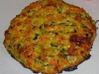A combination of shredded yellow summer squash, zucchini and carrot, plus onion, garlic, seasonings, Parmesan and egg, is shaped into patties and baked in the oven.