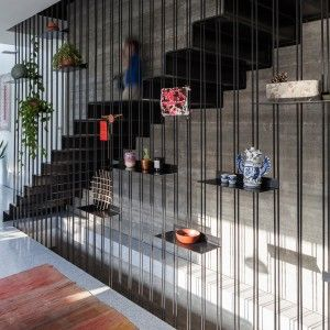 David Lebenthal's Tel Aviv townhouse features a staircase with shelves stuck to its steel balustrade