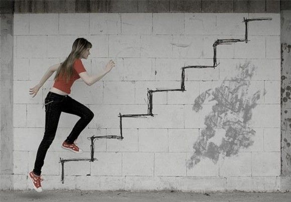 I like this picture because of the forced perspective. It's done so well that it looks like a poster, even though the stairs are drawn on a wall. I think the lighter paint behind the girl also frames the picture nicely. Overall, it's a simple yet effective photo.