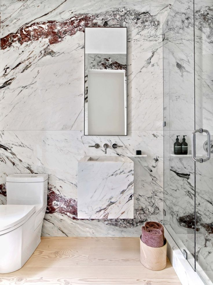 Veined marble walls. Visit houseandleisure.co.za for more.