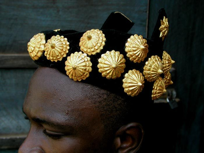 Africa | Abotire crown of gold leaf | This style of Ashanti crown is flexible, like a hat, but is covered with gold leaf-covered wooden elements. Its name in the Akan language is abotire. This is the oldest, most traditional of crown styles, worn by all levels of Ashanti royalty.