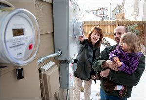 A family checks out their new net meter that measures the solar power generated against the power use for their solar lease. They expect their $107 average electric bill to drop to about $41 per month now that they've leased solar panels. The lease is costing them $64 per month.