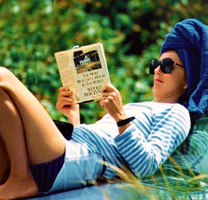 Jackie Kennedy sunbathing in Martha's Vineyard on her 60th birthday, 1989