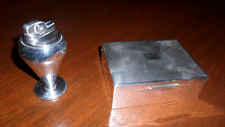 Silver cigarette holder and lighter. Relics of the 20th Century.