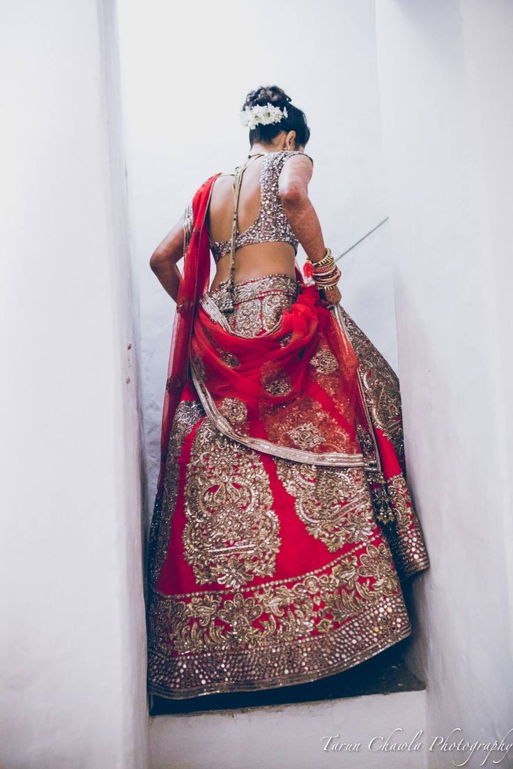 There's nothing like the classic red indian wedding lehenga with modern design on it. I love the way this indian bride carries the outfit, and the low back wedding blouse ties it all together. LOVE!