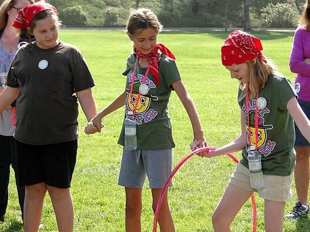 New relay game! Which line can get the hula hoop from one end to the other first.