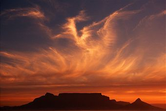 A healing sunset in view of one of the 7 wonders of the world - Table Mountain, Cape Town