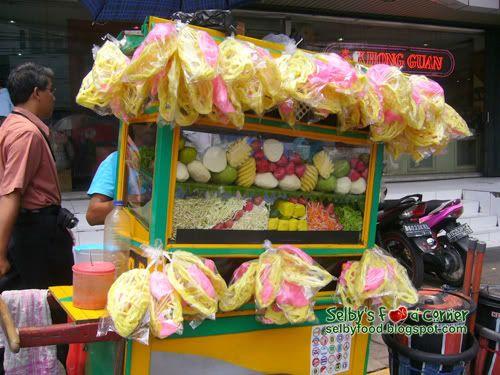 Street cart of asinan, Indonesian fruit salad.