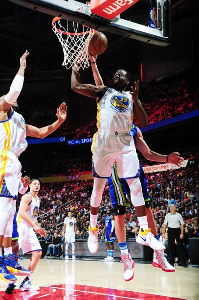 Draymond Green of the Golden State Warriors grabs the rebound against the Atlanta Hawks on March 6 2017 at Philips Arena in Atlanta Georgia NOTE TO...