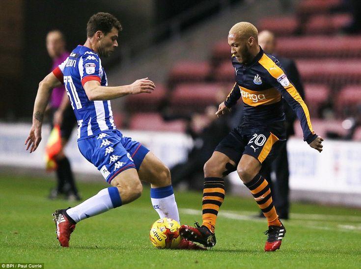 Wigan winger Yanic Wildschut (left) tackles Gouffran as he looks to regain possession for Warren Joyce's side