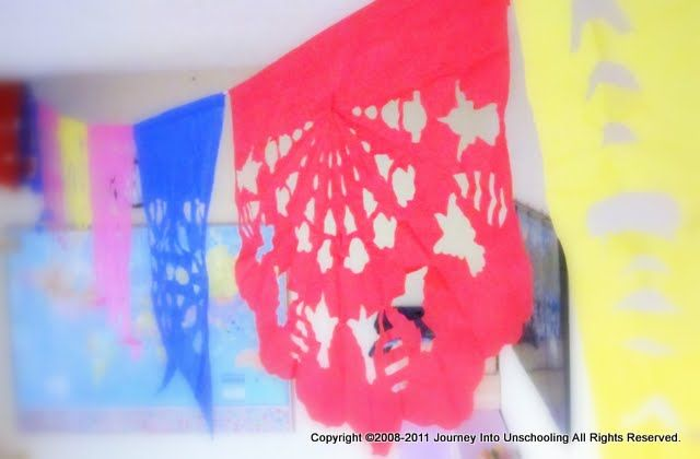 Do it yourself papel picado --- maybe I will http://unschoolme.blogspot.com/2011/02/making-magic-windows.html