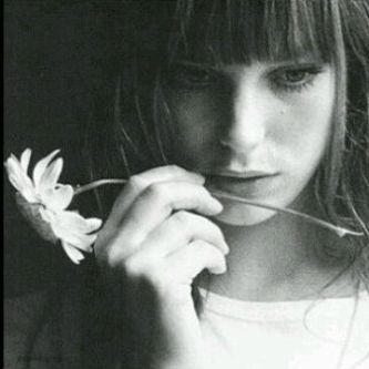 I wouldn't be holding a flower, but I like the concept. Maybe a cig instead or a blunt or a pen