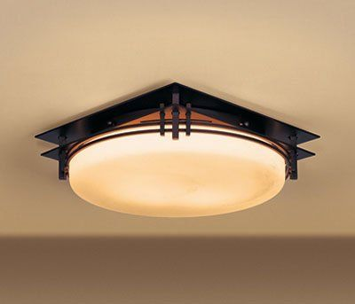 Flush mount ceiling fixture from the Banded collection. Lovely craftsman look granted by the hand forged iron sleek vertical lines atop a curving frame.