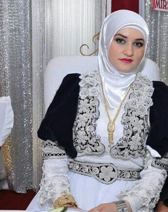 Hijab bride in blue - white traditional clothes