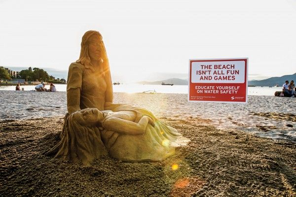drowning prevention sand sculpture ambient marketing vancouver taxi canada david billings 1