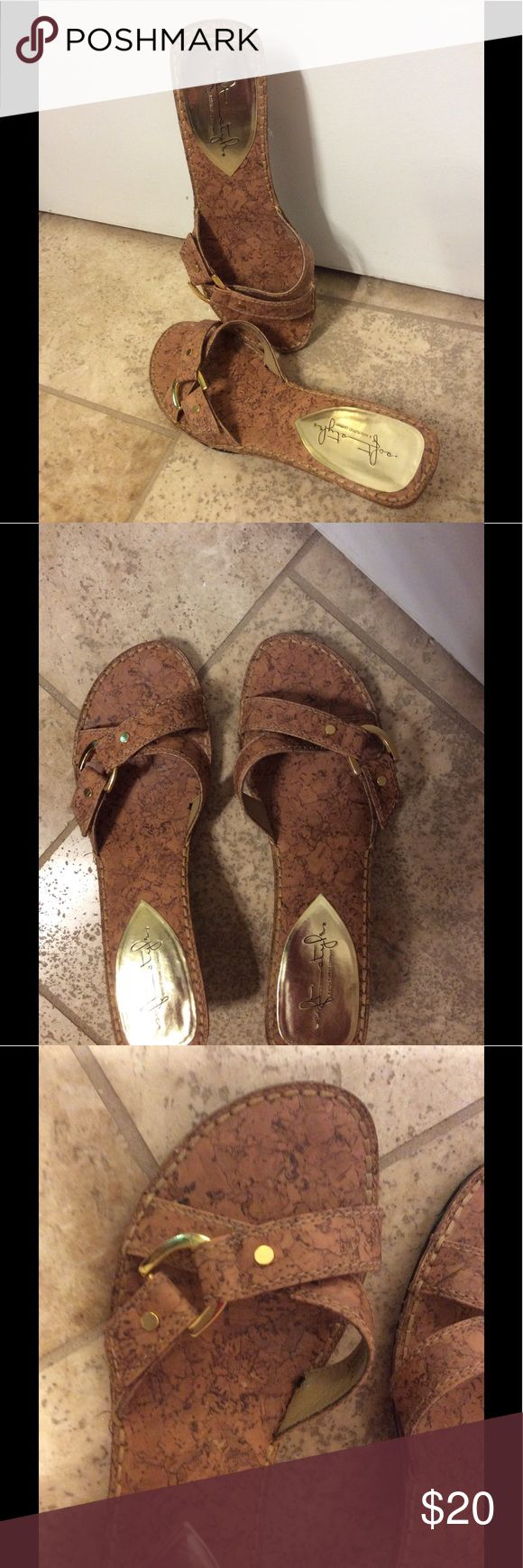 Hush Puppies Soft Style Sandal Beautiful simulated cork look Hush Puppies Soft Style, comfortable, easy to wear. Slide on/off.. Buckle decoration cross straps. Footbed great condition with wearing on the heels. Good condition. I also have the brown leather version. Smoke/pet free environment. Hush Puppies Shoes Sandals