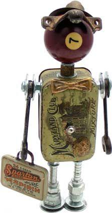 Baldrick   Principal Components: Tobacco tin, pool ball, wrenches, sash lock, lamp part, aspirin tin, hydraulic fittings, button