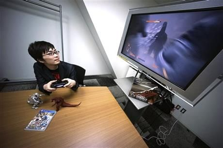 In this May 20, 2015 photo, Shunsuke Fujita, Godzilla video game's producer of Bandai Namco Entertainment, demonstrates new Godzilla game for the Sony Corp. PlayStation 4 home machine in Tokyo. (AP Photo/Eugene Hoshiko) ▼1Jun2015AP|New Godzilla video game steers clear of nuclear references http://bigstory.ap.org/article/1094bfd0b9e5440da828f5e0b3e6f8cf/new-godzilla-game-steers-clear-nuclear-references