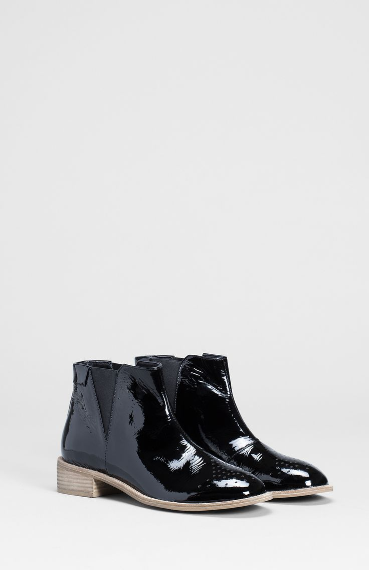 These Scandi inspired winter boots get their crinkled look from the use of patent cow leather. The Tretten Ankle Boots have a perforated toe that adds a point of difference and a layer of leather underneath the pattern means you won't be left with damp socks! Wedges of elastic on each side of the ankle allow you to slip them on and off with ease and the stacked heel adds height and comfort.