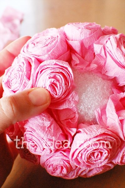 crate paper rose balls! -Kehnley saw this one and requested we make it t look like a flower ball from the LT wedding lol