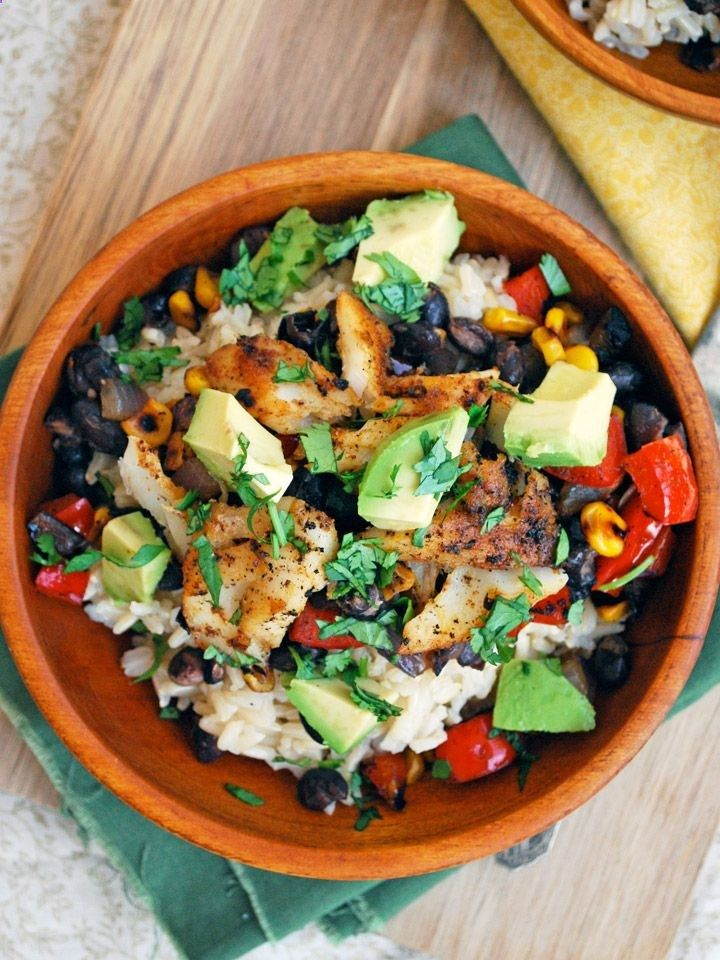 Fish Taco Bowls with brown rice, black beans, corn, and avocado .