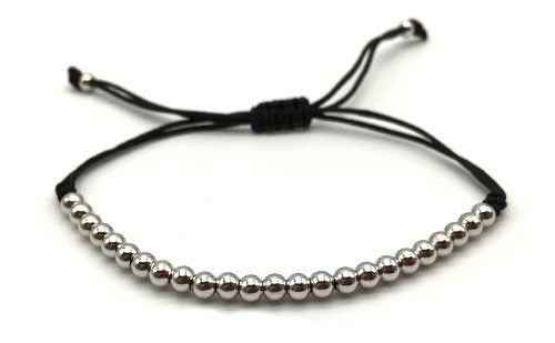 The Byron is crafted from platinum beads and rope. Adding casual character to an outfit, this bracelet stretches to fit any wrist size easily.