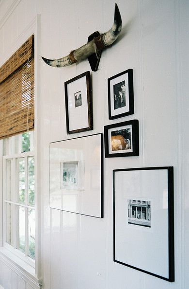 Living Room Photo - A grouping of framed art on white walls