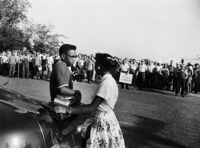 Students Steve Posten, 17, and Jessalyn Gray, 18, wait tensely beside a cab while a crowd of whites taunts them outside Texarkana Junior College, Texarkana, Tex., 1956. Jessalyn eventually asked police to escort them inside. When the police refused, the students left. Read more: How to Fool a Bunch of Angry Racists: Lesson 1   LIFE.com http://life.time.com/history/how-to-fool-a-racist-mob-lesson-1/#ixzz3DVV20osE