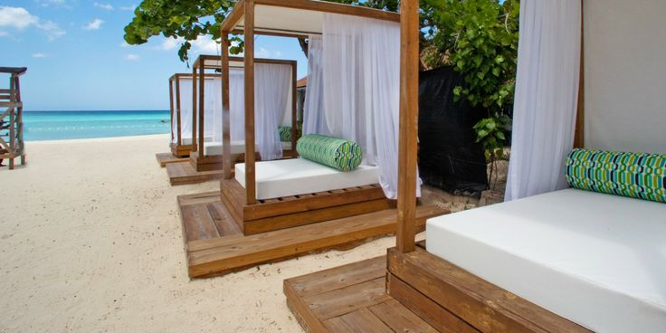 Jamaica - Sandy Haven's chic beach cabanas create an outdoor living space just steps from the sea. #Jetsetter
