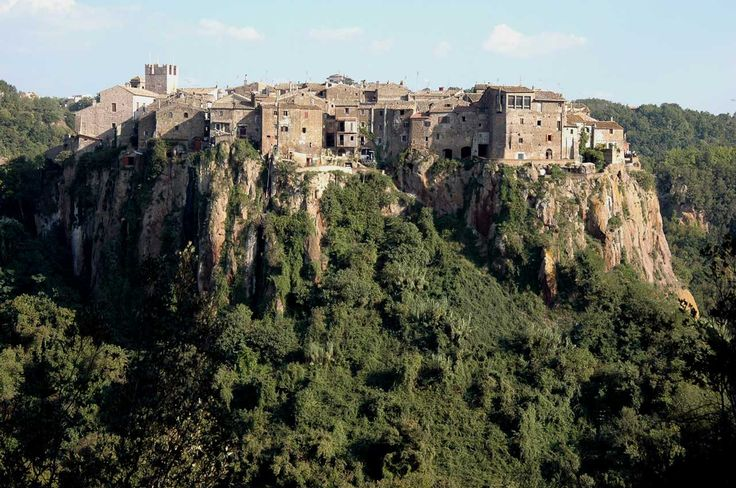 Calcata, an Ancient Town near Roma - In the 1960s, the emptied historical centre began to be repopulated by artists and hippies who squatted in its medieval stone and masonry structures. Many of the squatters eventually purchased their homes, the government reversed its condemnation order, and the residents of what had become an...   http://wp.me/p5qhzU-ck   #Italy #Travel