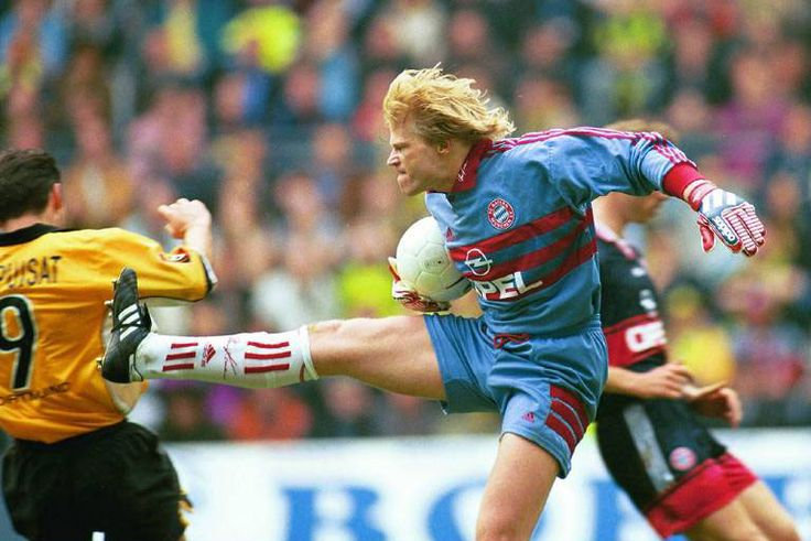 Kung-Fu Kahn. Bayern München's goalkeeper Oliver Kahn lunges feet first into Stephane Chapuisat in a match against Borussia Dortmund on April 3, 1999.