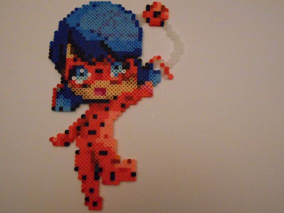 Perler bead art of Marinette as Ladybug from the cartoon Miraculous Ladybug. -Partially melted on both sides of the beads.  -If under 10 items are bought from my store at once, additional shipping prices will not be added.  -If you wish to request a Perler bead piece, feel free to contact me. I am always taking suggestions however, prices vary on size.  -US and Canada only