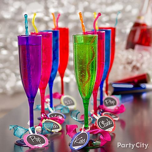 The New Year is looking bright! Celebrate with vibrant flutes of bubbly and DIY glass markers - just click the pic to see how!