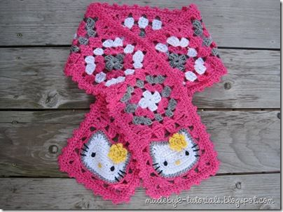 """Hello Kitty Scarf: This pattern is for a crocheted Hello Kitty Granny Square Scarf as shown above – a scarf with a Hello Kitty Granny Square at each end and seven regular granny squares in between (four with white at the center, three with grey). The scarf, intended for a 5-year-old girl, ended up about 45"""" long."""