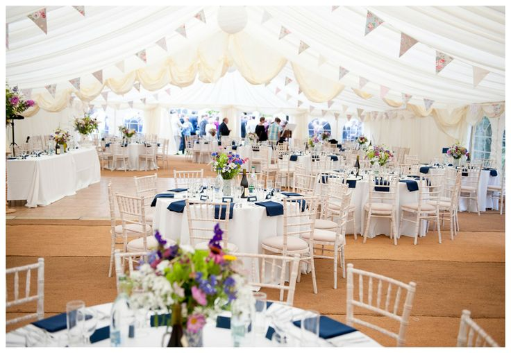 Pennant flags hanging from tent top beautify your for Indoor marquee decoration