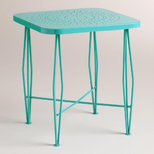 Bring a midcentury look to your patio or deck with our hairpin table decorated with a punched floral pattern. Crafted of metal in a vibrant blue finish, this mod-inspired accent table also doubles as a seating option.