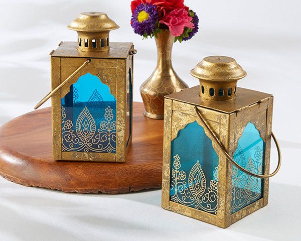 No Indian wedding decor is complete without Kate Aspen's beautiful jewel tone lanterns. Blending the elegance of the West with the vibrance of the East, these luminous decor elements feature an antiqu