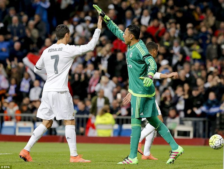 Ronaldo high fives Real Madrid goalkeeper Keylor Navas after the Costa Rican saved a penalty with the score at 1-0