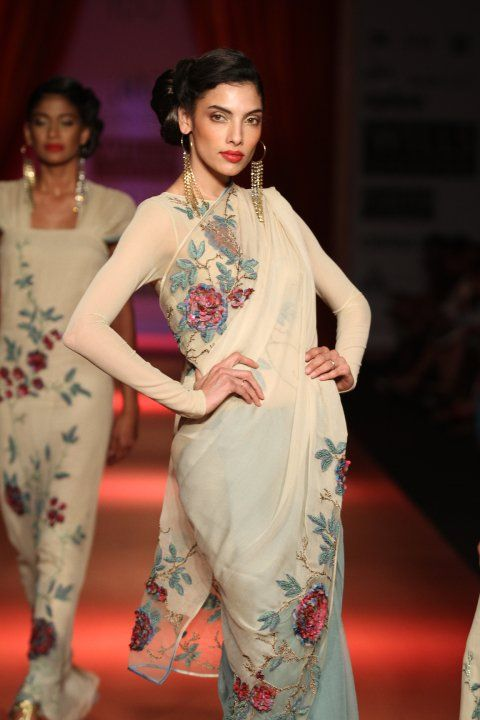sophistication. This is great inspiration for my cream embroidered sari. Blouse: Sheer nude, long sleeves, neck covering collarbone, very low back.