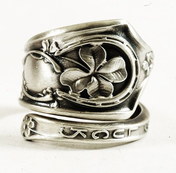 Very unique Four Leaf Clover sterling silver spoon ring! This spoon depicts a lucky 4-leaf clover, a horse shoe, wishbone, old shoe and rabbits food, all in crisp detail! The words Good Luck are on the front. Nice light weight spoon ring if you prefer the lesser bulky spoon rings. The