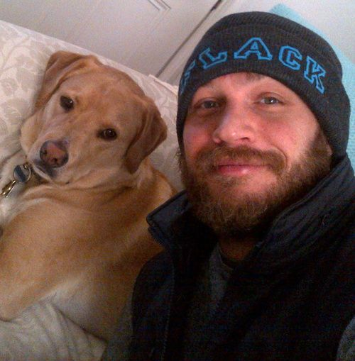 The very sexy Tom Hardy and his dog Woodstock that was a stray he saw running around on a freeway and rescued :)