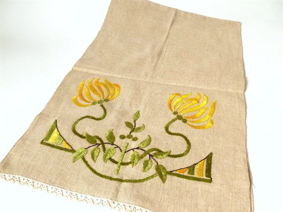 Amazing detail and color on this embroidered hopsack linen table runner. Very fine and well done needlework forms flowers, leaves and abstract