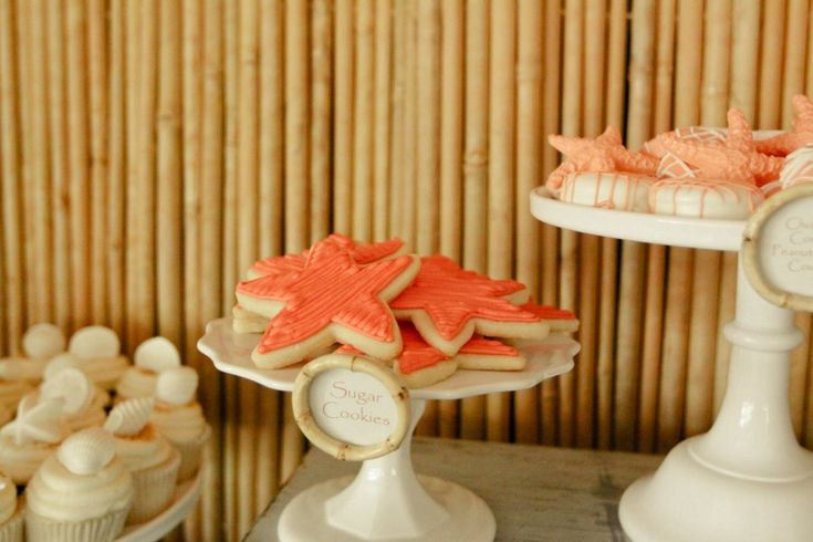 Starfish sugar cookies. These orange cookies were perfect at a Hawaiian themed dessert table! Jennycookies.com