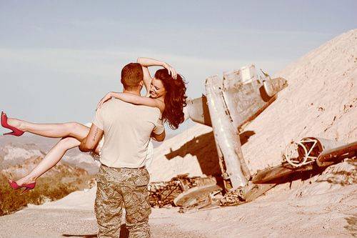 Cute military couple's photo. LOVE the read heels. Her smile says pure happiness in his arms <3