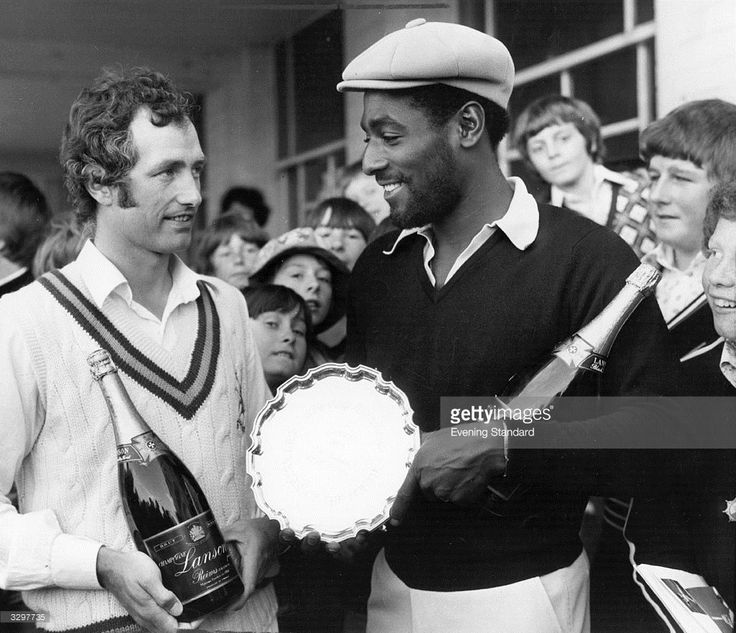 Viv Richards is presented with the Evening Standard's Cricketer of the Month award, which includes a magnum of champagne.