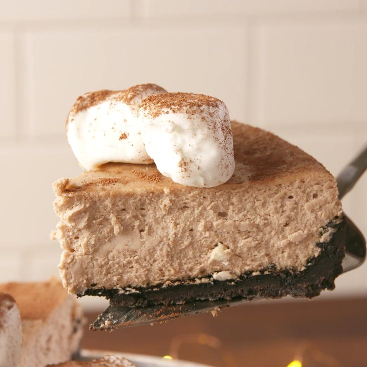 Cuddle up with a big slice of this Hot Cocoa Cheesecake. #food #easyrecipe #dessert #cheesecake #cake