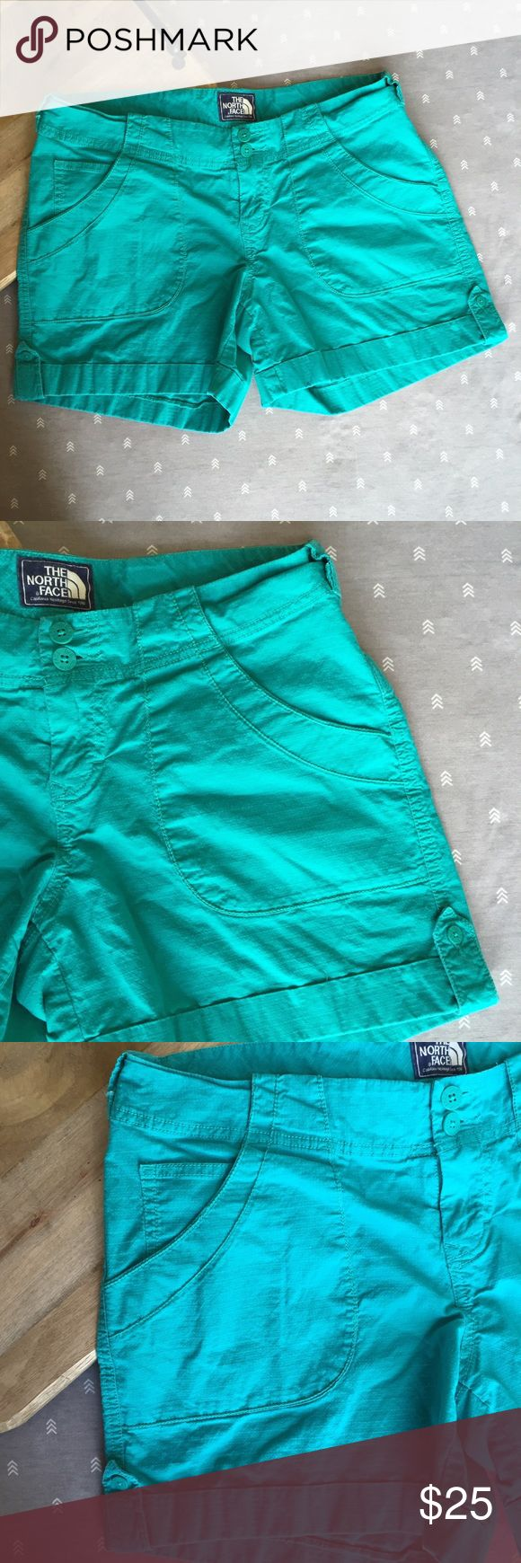 North Face teal/turquoise shirts North Face shorts. Teal/turquoise color. Back pockets, button closure. Two-button closure. Pre-loved - great condition, no major signs of wear. North Face Shorts